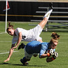 Hayley Hughes of Colorado, collides with Texas keeper, Alexa Gaul, on Sunday.